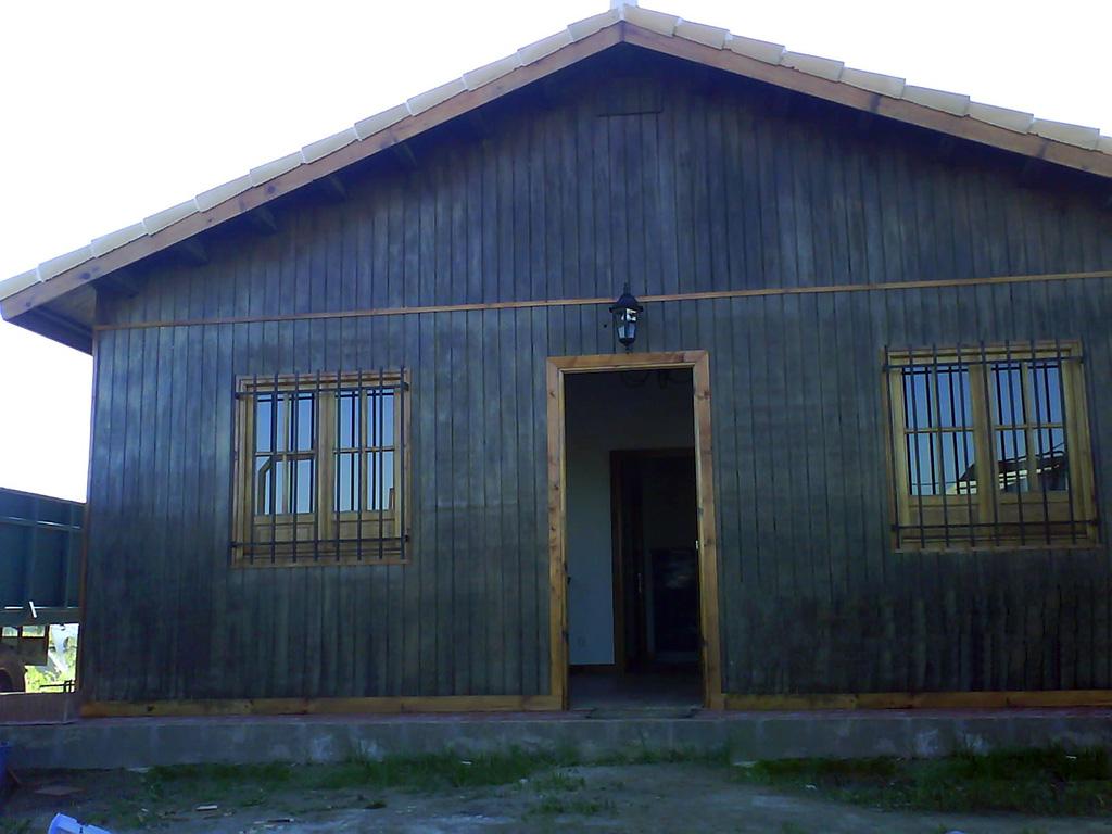 Casa unifamiliar de madera sin porche casas de madera a medida for Casas de madera a medida
